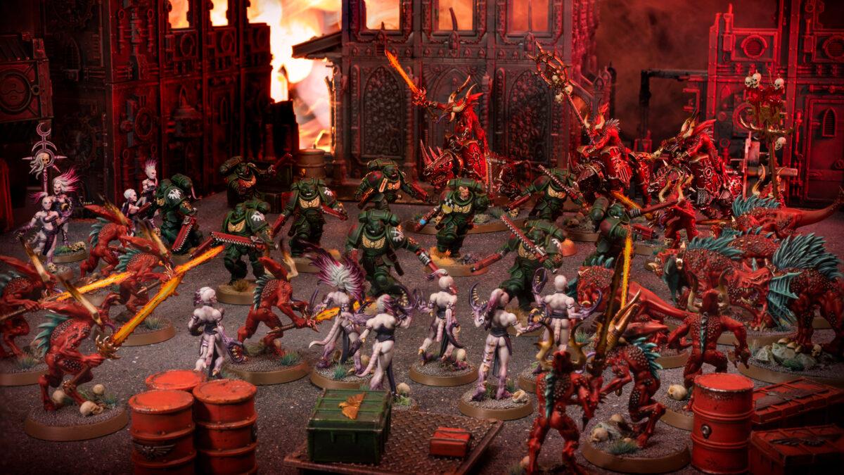 Dark Angel Assault Intercessors are surrounded by Khorne and Slaanesh Daemons