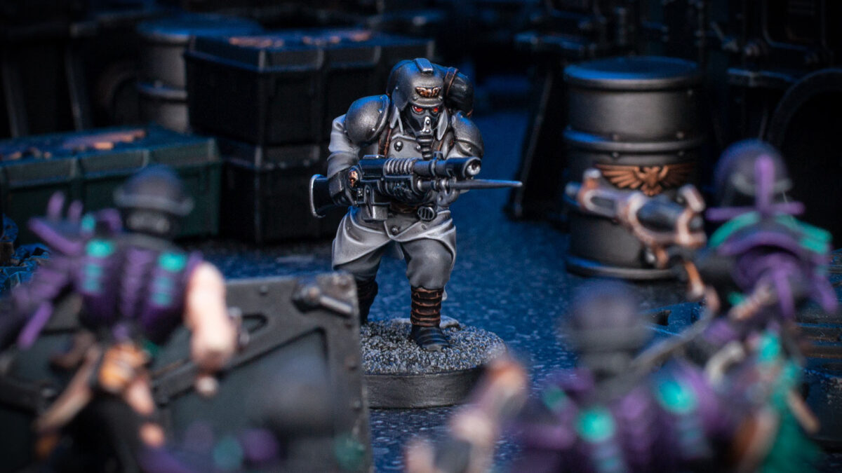 Cinematic shot of a Death Korps of Krieg Guardsman fighting against Drukhari Wyches